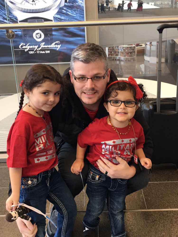 Sisters Send Surprise Transcontinental Hug To Dad On Peace Mission Strathmore Times